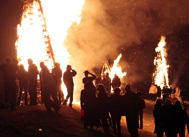 Bonfires light the way on the levee for Papa Noel in St. James Parish