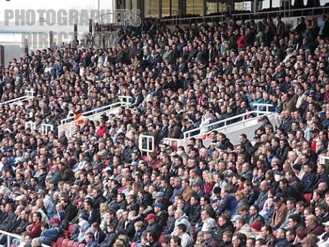 West Ham Football stadium crowds of spectators watching match in progress