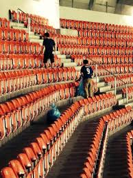 3 Japanese Fans cleaning Stadium