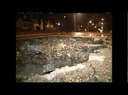 Actual Jackson, MS pothole awaiting prayer...