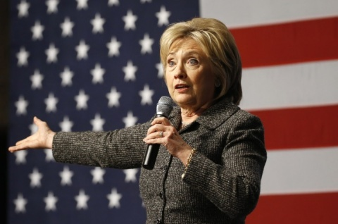 Hillary in front of the flag