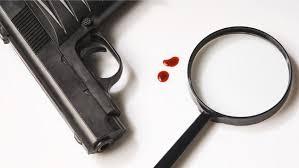 gun and Magnifying Glass